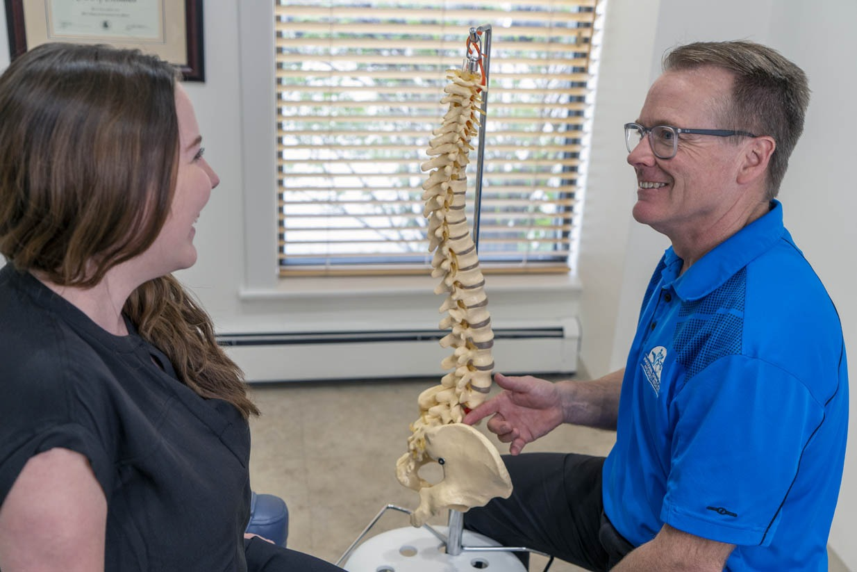 National Spine Care | Dr. Gord McMorland Explaining Spine To Patient
