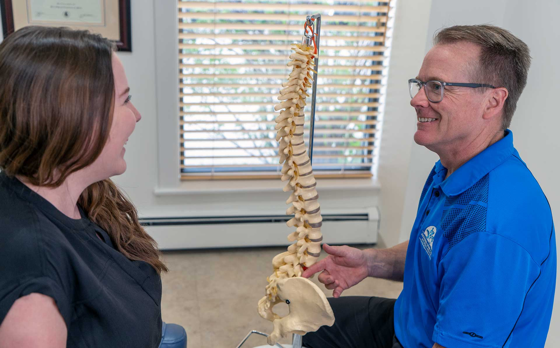 National Spine Care | Explaining to Patient